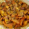 Vegetarische linzencurry stoofpotje met wortel, tomaat en zoete aardappel