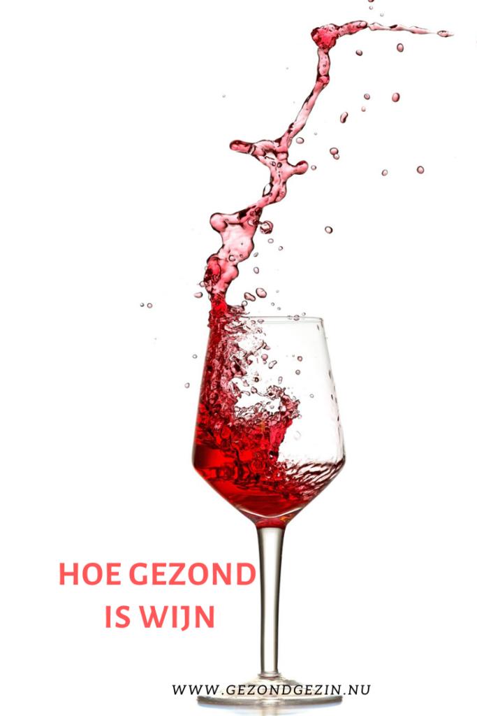 Een glas wijn met de tekst hoe gezond is wijn?